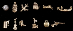 Various yellow gold charms.
