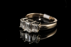 14Karat yellow 3stone Emerald cut diamond 1.25ctw G-H/VS2 ring. $3750