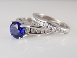 14Karat white gold lab created sapphire and diamond ring. $1800 18Karat white gold diamond channel band. $800