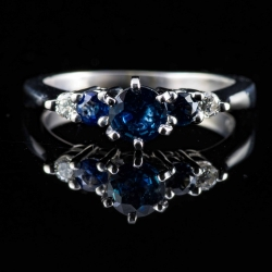 Platinum sapphire and diamond ring. $1400