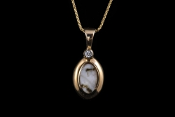 14Karat yellow gold with diamond and gold quartz pendant. $560