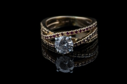 14Karat yellow gold Moissanite ring with ruby and sapphire stones. $550