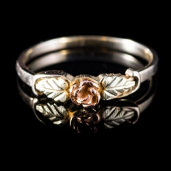 10 Karat Yellow and Rose gold ring with carved Rose and leaves. $40