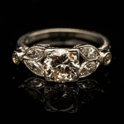 Ladies Platinum Diamond Engagement Ring. Approx. 1ct Center Diamond and Marquise Shapped sides. $5500