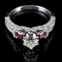 14 Karat White Gold Diamond Engagement Ring. .96 Oval Cut Diamond I1 I. Ruby Sides $4000
