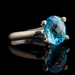 14K Two Tone Blue Topaz Ring with Diamonds set into the Prongs. $225