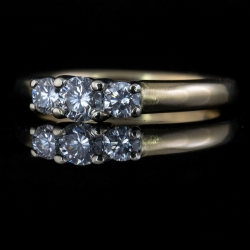 14kw Three Diamond Ring. Approx .38cttw Size 5$450
