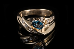 14Karat yellow gold oval london blue topaz and diamond channel ring. $450