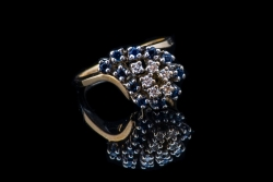 14Karat yellow gold diamond and sapphire cluster ring. $350