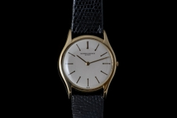 18Karat yellow gold Vacheron & Constantin Geneve watch with black genuine lizard band. $2200