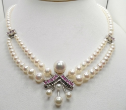 "14 Karat white gold pearl and pink sapphire 18"" necklace. $3000"