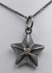 Sterling Silver oxidized diamond and star necklace. $125