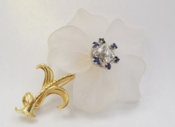14Karat yellow gold carved quartz flower pin with sapphire and diamonds. $750